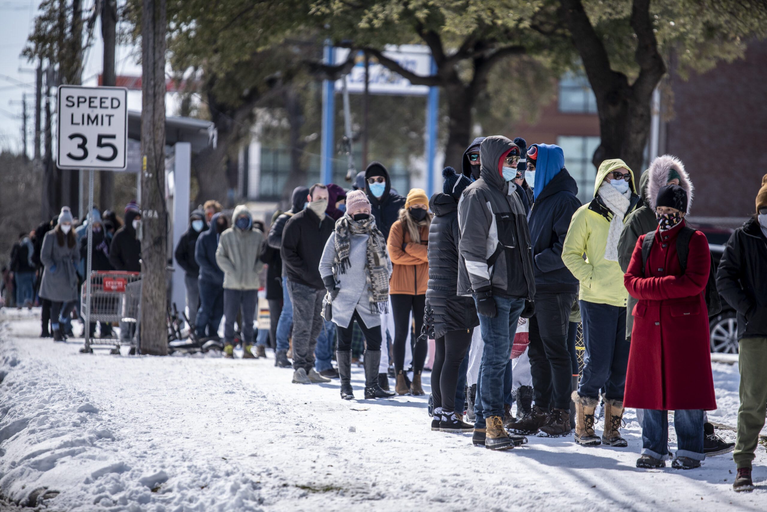 People wait in line at a grocery store in Austin, Texas on Tuesday, Feb. 16, 2021. Credit: Sergio Flores for The Washington Post via Getty Images