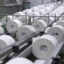 Rolls of toilet paper move along a conveyor on the production line at a factory in Fuji, Japan, on Tuesday, Sept. 7, 2021. Credit: Toru Hanai/Bloomberg via Getty Images