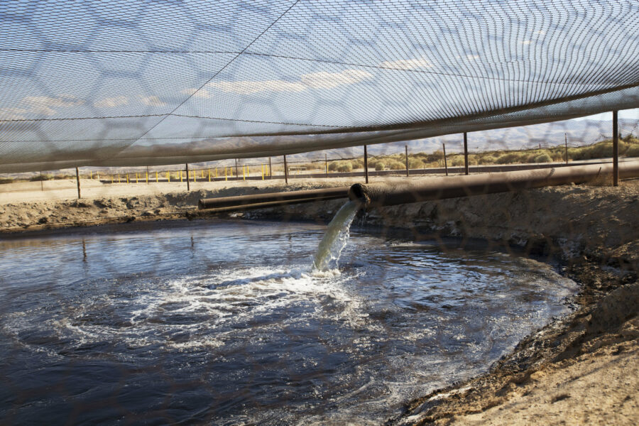 Fracking fluid and other drilling wastes are dumped into an unlined pit located right up against the Petroleum Highway in Kern County, California. Credit: Sarah Craig/Faces of Fracking