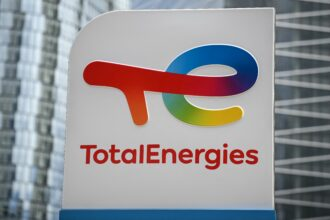 This photograph taken on May 28, 2021 shows the new TotalEnergies logo during its unveling ceremony, at La Defense on the outskirts of Paris. Credit: CHRISTOPHE ARCHAMBAULT/AFP via Getty Images