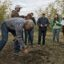 Nick Edsall, orchard manager for Bullseye Farms, describes the benefits of cover crops and soil health during a farm tour for World Soil Day 2019. Credit: Becca Lucas