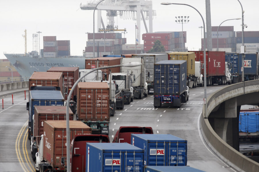 Shipping container trucks sit in traffic as the International Longshore and Warehouse Union strikes, putting a halt to most of the work at the busiest seaport complex in the nation on November 29, 2012 in Long Beach, California. Credit: David McNew/Getty Images