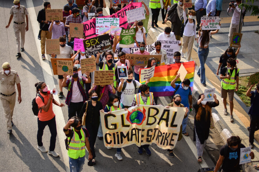 Protesters hold banners and placards as they participate in a protest march during a global climate strike, part of the 'Fridays for Future' movement in New Delhi. Credit: Manish Rajput/SOPA Images/LightRocket via Getty Images