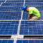 A panel installer finishes installing electrical wiring at a solar array at a job site in East Charlotte. Credit: Logan Cyrus for The Washington Post via Getty Images