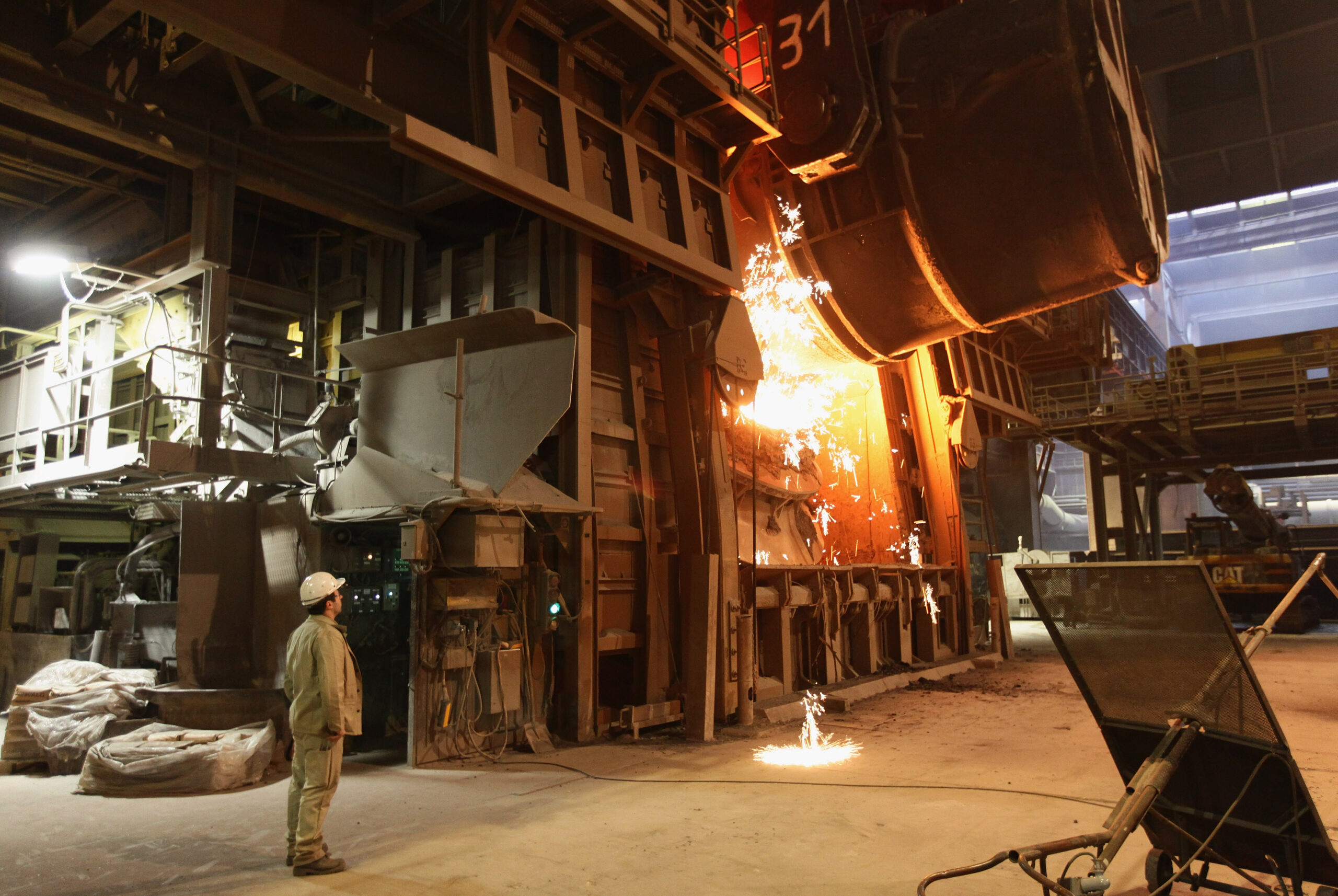 A worker watches as molten iron flows into a furnace for purification and alloying to become steel at the ThyssenKrupp steelworks on Jan. 13, 2010 in Duisburg, Germany. Credit: Sean Gallup/Getty Images